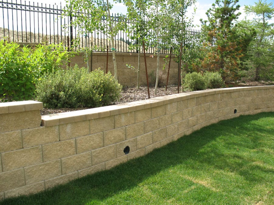 medium retaining wall with precast fence wall on top