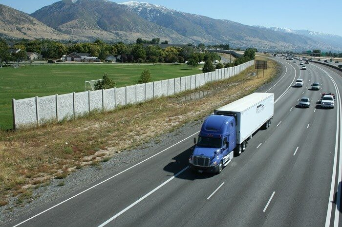Highway sound barriers protect people from the noise pollution generated by cars, trucks and traffic.